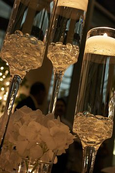 candles in champagne glasses....table decor