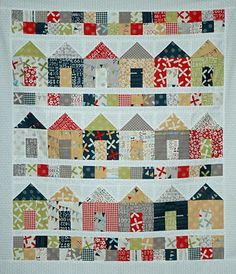 Surrounded by houses quilt with Sweetwater fabrics on A quiting life's blog