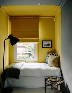 """[link url=""""https://www.stylelibrary.com/sanderson/""""]Sanderson[/link]'s 'Mimosa Yellow' paint brightens one of the bedrooms."""