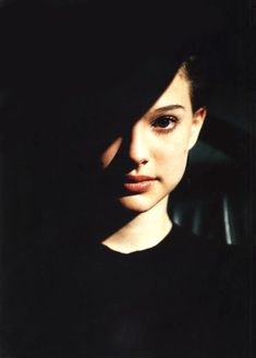 Natalie Portman looks like Audrey Hepburn here. Great contrast between the black shadows and her face