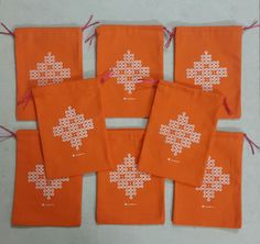 Beautiful custom designed, high quality CANVAS drawstring bags with a CLASSIC kolam design!  Are you tired of the glittery silk Potli bags flooding the market? Are you looking for something more elegant and pretty?  We are now selling high quality canvas drawstring bags with a classic kolam design on it. Versatile for any festive occasion, it is gauranteed to bring a smile on your face!   # Festival #return #gift #bags #navratri #diwali #golu #Potli #thamboolam #kolam #Custom #design