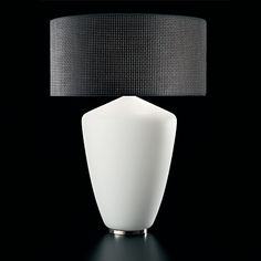 Barovier & Toso - Tradition marries innovative materials in this collection of lamps. A white or black sanded glass base is topped with a shade in a choice of two types of high-tech fabric.