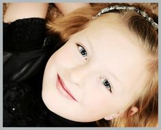 Close-up portrait of an 8 year old girl in a Utah photo studio