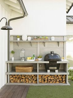 Bbq Area Painted In Muted Tones - Ideas About How To Add Character And Privacy To A Blank Canvas Outdoor Space Such As A New Build Garden.