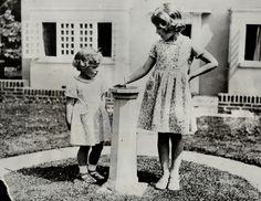 Princess Margaret & sister Princess Elizabeth (later becomes Queen Elizabeth II) Circa 1932.   - HarpersBAZAAR.com