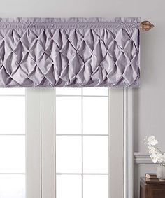Dress up windows with a sophisticated air using this ruffled valance. Its gorgeous patterning and color add a classic accent to décor for an elegant feel.60'' W x 20'' H100% polyMachine wash cold; tumble dryImported