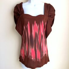 Anthropologie One September Brown Top Blouse S This top is in excellent condition. It soft, satin-like polyester sleeves and a 100% Modal body. It's really comfortable and soft and I think the sleeves add a nice unique flair. It's so versatile and can be worn with a number of casual coordinates Anthropologie Tops