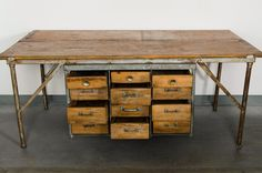 Paddle8: Industrial Work Table with Drawers - American