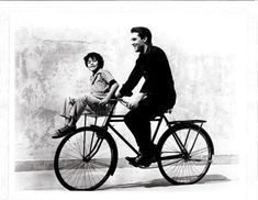 Elvis Presley and Larry Domasin ride a bike.  Tags: Elvis Presley Larry Domasin Fun in Acapulco Paramount 1963
