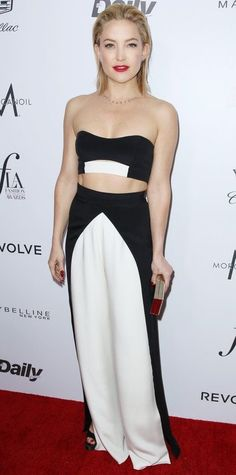 Kate Hudson at the Fashion Los Angeles 2016 Awards in a black-and-white color-block bandeau and high-waist faux-wrap pants by August Getty Atelier, styling with Jennifer Meyer jewelry and a Lee Savage box clutch.