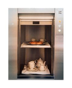 A garage-to-kitchen dumbwaiter is a must for our next house. with adjustable shelves