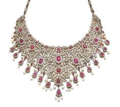 RUBY, CULTURED PEARL AND DIAMOND NECKLACE Of bib design, composed of floral and foliate motifs embellished with cushion-shaped and circular-cut rubies, accented with circular- and single-cut diamonds, suspending a fringe of pear-shaped rubies, framed with circular- and single-cut diamonds and cultured pearls, length approximately 370mm.