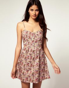 SUN DRESS This country style floral sun dress with thin shoulder straps and wide neckline looks very sweat.