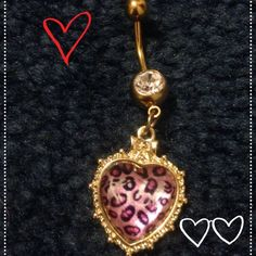 Belly Button Ring: Leopard Heart One of a kind, gold heart shaped belly button ring. It has an adorable pink leopard design inside the heart with clear crystal. Handmade by me, it's truly unique! Melissa Smith Jewelry