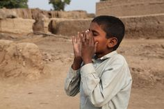 Boy from Lashkar Pur Children's Forum in Pakistan shouting an emergency warning to villagers. Plan set up the Lashkar Pur Children's Forum in 2009 to help prepare the community for flooding. Plan's Disaster Risk Management Programme (DRM) works to strengthen communities' awareness and resilience to flood related risks in at least six districts along the Indus River Belt.    #LDSEmergencyresources #Disasterplanning