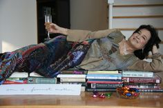 I captured my mother, Nancy Thayer, with chocolate and champagne on a bed of books! She is my original feminist mother, a tremendous inspiration for my novels too.
