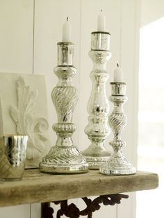 stunning antiqued mercury glass candlestands