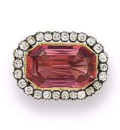 A 19th century pink topaz and diamond brooch. The step-cut pink topaz within an old brilliant-cut diamond border, mounted in silver and gold collet settings, diamonds approximately 1.60 carats total, length 2.6cm