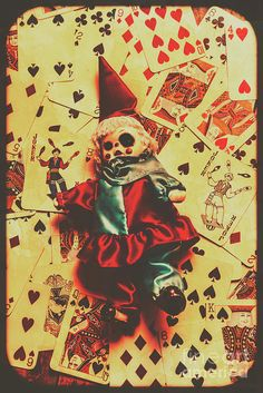 Spooky evil clown toy doll on scattered casino playing cards background, black magic and fortune telling by Jorgo Photography - Wall Art Gallery