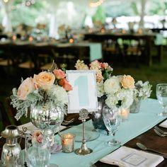 Elegant centerpieces in distressed silver vessels | Photographer: Kristyn Hogan | Cedarwood Weddings