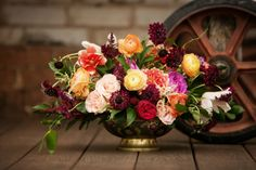 Robust centerpiece from Emerson Events. Click to see what types of flowers were used! Photo by Andrea Murphy Photography. #centerpiece #flowers #wedding #decor