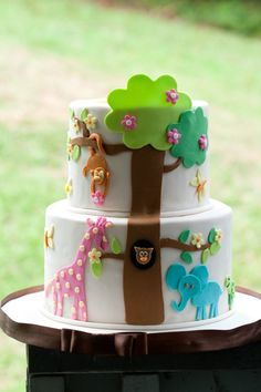 I like the PINK giraffe - love seeing nontraditional colors on the animals to make it more FUN!!!!!!! jungle cake.