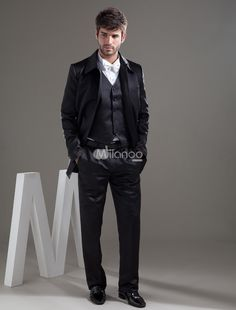 Traditional Black Worsted Groom Wedding Wear. This black jacket features its traditional full length style.The matching pants has zip fly with hook-and-bar closure.Jacket,necktie,vest and pants are included.. See More Groom Suits and Tuxedos at http://www.ourgreatshop.com/Groom-Suits-Tuxedos-C918.aspx