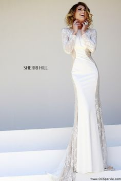 Sherri Hill 32027 This alluring evening gown features a close neckline with V-back design. The fitted bodice flatters your gorgeous ...