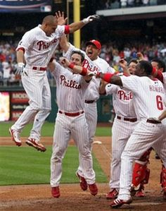 Phillies All Star Outfielder Shane Victorino is mobbed by teammates after his walk off homerun.