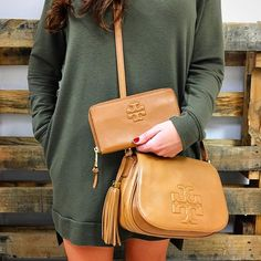Totally into Tory Burch! Call us at 813-258-8800 or email us at customerservice@mymoshposh.com if you would like to purchase before they go online!