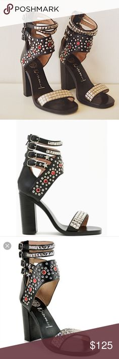"""Jeffrey Campbell Lakota Studded Sandals These are sold out everywhere!!!!!  Lakota' Jeffrey Campbell studded sandals are sold out everywhere! Because they SLAY any outfit. $170 originally and only worn a few times. In great condition. Sabo skirt, hello Molly, missguided, nasty gal style! Black leather upper with silver tone studs and red jewel details Silver pyramid studded toe band Leather lining Two decorative and two adjustable straps with silver tone hardware 3 1/2"""" stacked wooden heel…"""