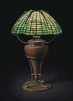 'SPIDER' TABLE LAMP, CIRCA 1910  leaded glass, patinated bronze  24¼ in. high, 16 in. diameter of shade. base and oil canister stamped TIFFANY STUDIOS NEW YORK 190, shade stamped TIFFANY STUDIOS NEW YORK