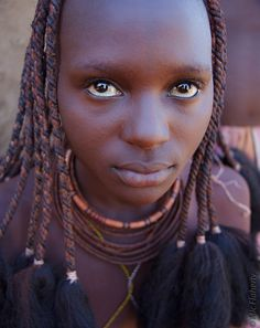 https://flic.kr/p/bmD3MS | Himba's Gaze | A young Himba woman in northern Namibia is more than ready for her closeup.