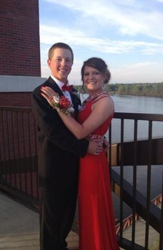 """Prom 2013 with Baseball Roses  """"Bradley asked Payton to prom by writing on a baseball. When I found these online, I couldn't think of any better way to keep the theme going. Great idea and different.""""  Bradley's Baseball Rose Boutonniere can be purchased here. Payton's wrist corsage was custom made using Baseball Rose Corsage Stems. You can purchase corsage stems from the Sports Roses online store and bring them to your local florist to create your own custom corsage."""
