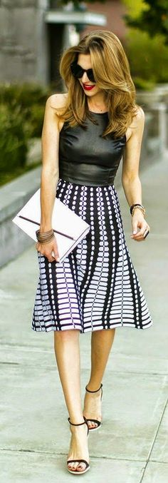 Street style | Black leather top, printed skirt