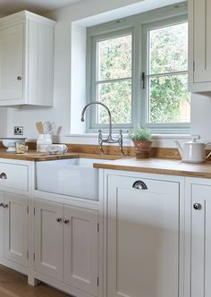 Pale/neutral cupboards & walls with slim oak & honey floor - lovely