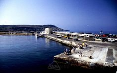 What a difference from today! Passengers wait for the next boat to Gozo in the sunshine at the Cirkewwa ferry terminal in 1995