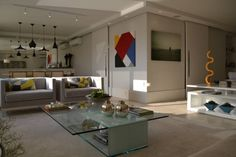 Shades of gray: Salas de estar translation missing: br.style.salas-de-estar.minimalista por Helô Marques Associados