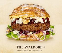 THE WALDORF –  –THE TOPPINGS & FIXINGS: Wisconsin Blue Cheese, Beef Patty, Toasted Walnuts, Dried Tart Cherries, Curly Endive, Sliced Red Onions, and Dijon Mustard on a Rustic Italian Roll.