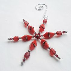 #Red #Snowflake #ChristmasOrnament #HandmadeGift #StockingStuffer #giftideas #christmasgift #dravynmoor #redornament