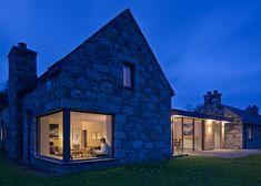 Stone and glass Torispardon House is a modern take on traditio...