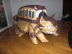 The Catbus is a character in the Studio Ghibli film My Neighbor Totoro, directed by Hayao Miyazaki. It is a large creature, depicted as. Chat Bus, Totoro Merchandise, Papercraft Download, Paper Art, Paper Crafts, Anime Store, Paper Animals, Kawaii, Idee Diy