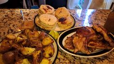 Fried pork chops and cheesy pupupas, roasted potatoes and homemade applesauce