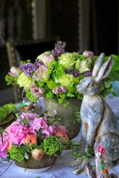 Easter/Spring vignette with flower arrangements and rabbit. So Pretty!