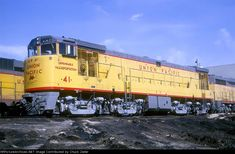 UP U50 41 Description: Union Pacific Railroad U50 41 at Council Bluffs, Iowa on May 2, 1965, Kodachrome by Lou Schmitz, Chuck Zeiler collection. Built around August 1964 (c/n 35101), retired and traded to GE January 1974. A batch of 12 were delivered between July and September 1964, while a final eight were built May through August 1965. They were numbered 31-53. The number 72 appears in the engineer's side number board, and at the time of this photo, the UP (and the SP) were using the…