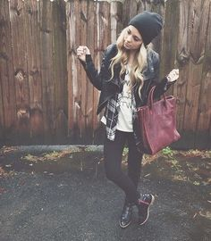 Black and gray plaid shirt with black jeggings and gray beanie