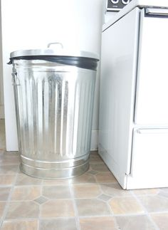 How about a regular tin garbage can for vintage look. via carol miastram gillam