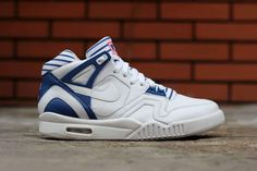 """Nike Sportswear has crafted what may be yet another """"Grand Slam"""" edition of the Air Tech Challenge II with this upcoming pinstriped take on the iconic '90s tennis silhouette. Donning predominately whi..."""
