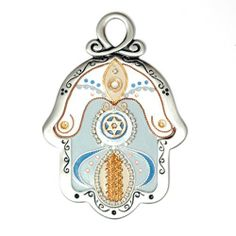Gold and Blue Toned Pewter Hamsa Wall Hanging by Ester Shahaf by World of Judaica. $78.00. A stylish pewter wall Hamsa handmade at the studio of Ester Shahaf and decorated with copper thread, rows of Swarovski crystals and a Star of David. This elegant wall Hamsa would make a great addition to your home decor and will provide protection from the 'evil eye' at the same time! This Hamsa wall hanging has been handmade out of pewter by Ester Shahaf, a well-known Israeli a...