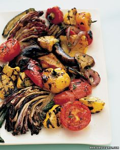 Grilled Garden Salad ~ Wow what a wonderful dish for end of summer celebrations ~  Charring on the grill sweetens and intensifies the flavor of eggplant, asparagus, tomatoes, patty pan squash, radicchio, red onion, bell peppers, and portobello mushrooms. Arrange the grilled vegetables on a platter, sprinkle with fresh thyme and lemon juice, and serve warm or at room temperature. marthastewart.com